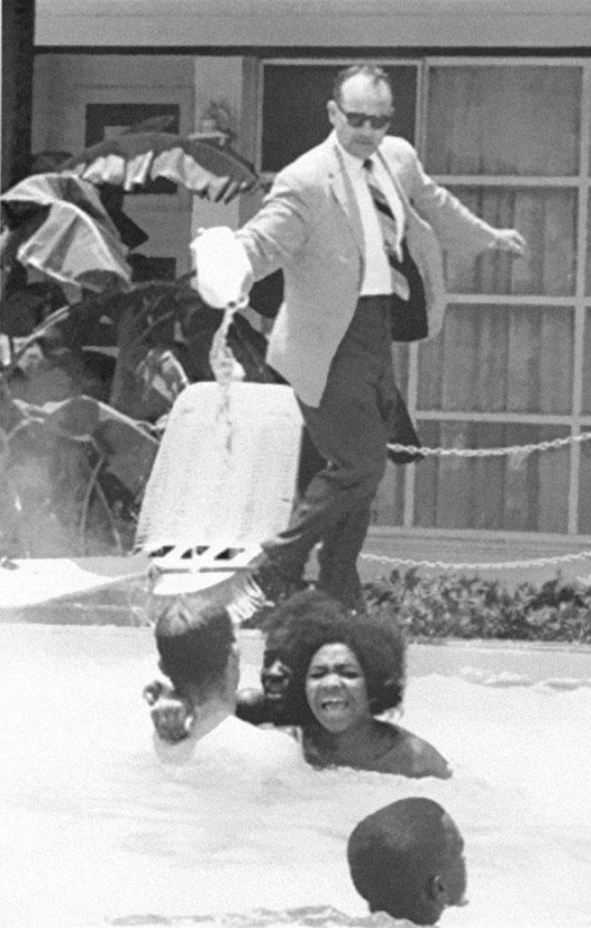 25-Hotel-owner-pouring-acid-in-the-pool-while-black-people-swim-in-it-ca-1964