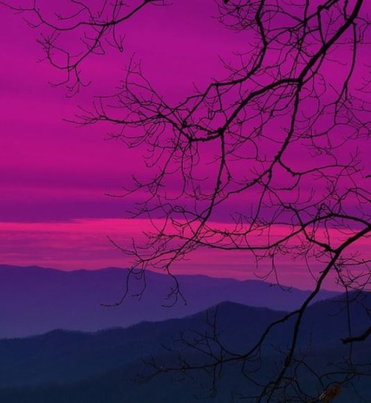 Enhanced purple skies over purple mountains